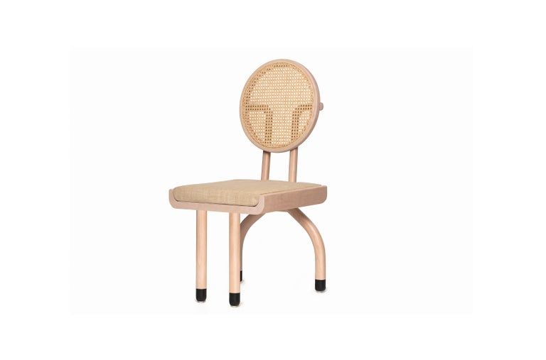 Take a seat in our Dumick chair. A large round back with woven cane will let your back rest. Long legs and a comfortable seat will give you comfort while enjoying a pleasant conversation.  *Solid beech wood frame. *Natural matte finish.