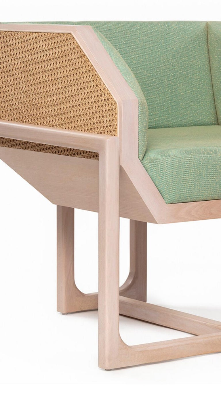 Hand-Crafted Mid-Century Modern Style Wood Armchair with Woven Cane Upholstered in Textile For Sale
