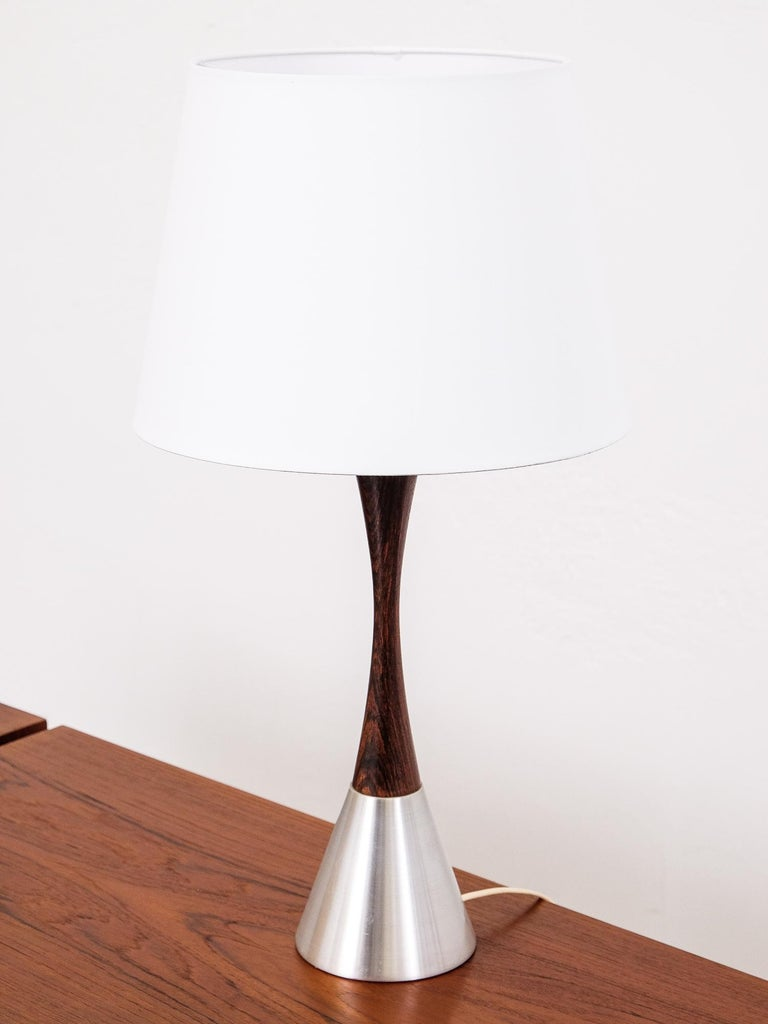 Rare table lamp by Bergboms, Sweden, 1960s. The lamp is made of rosewood and brushed metal. Design of this lamp is simple and elegant and the wood and the metal make a beautiful contrast.