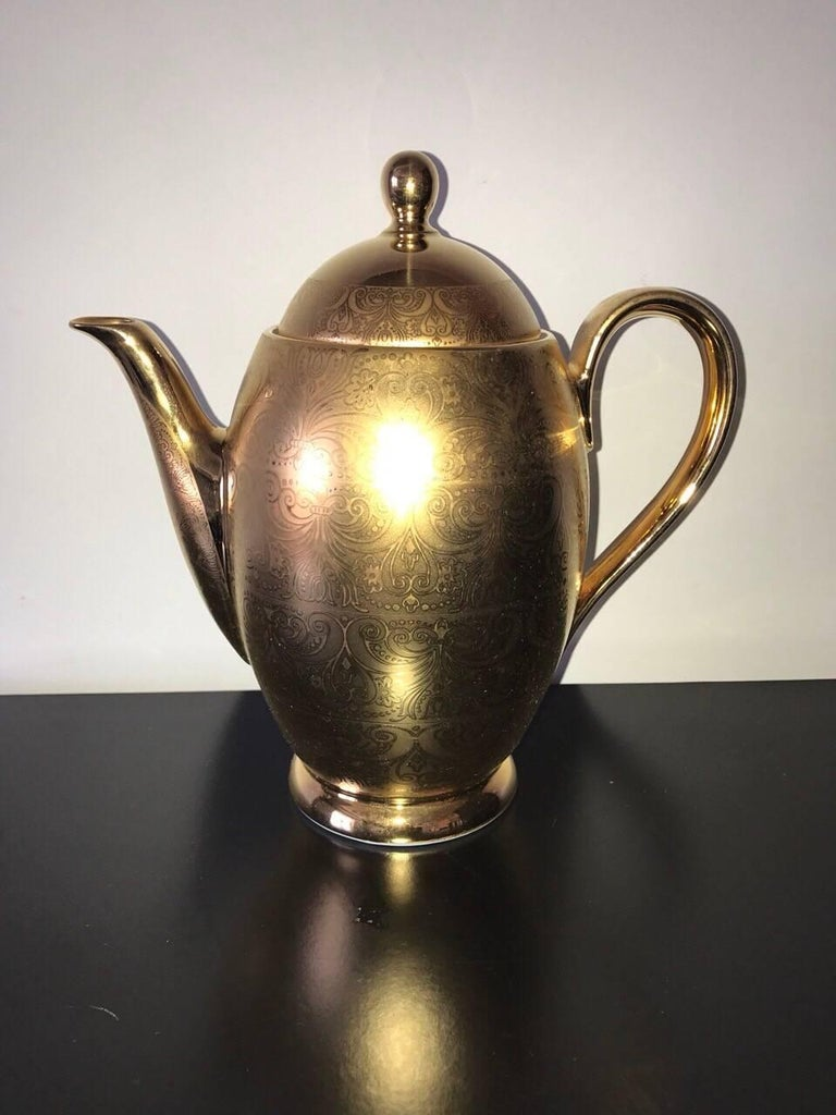 "Amazing tea set gold leaf.  QUALITY ROYALE LIMOGES-FRANCE 22 KAR GOLD TEA SET 15 pieces: 1 tea pot with lid aprox. 9 1/4"" h 1 sugar bowl with lid aprox 4"" H 1 creamer 3 1/2"" h 6 cups 3 1/4 h 6 saucers, 5 1/2 diameter"