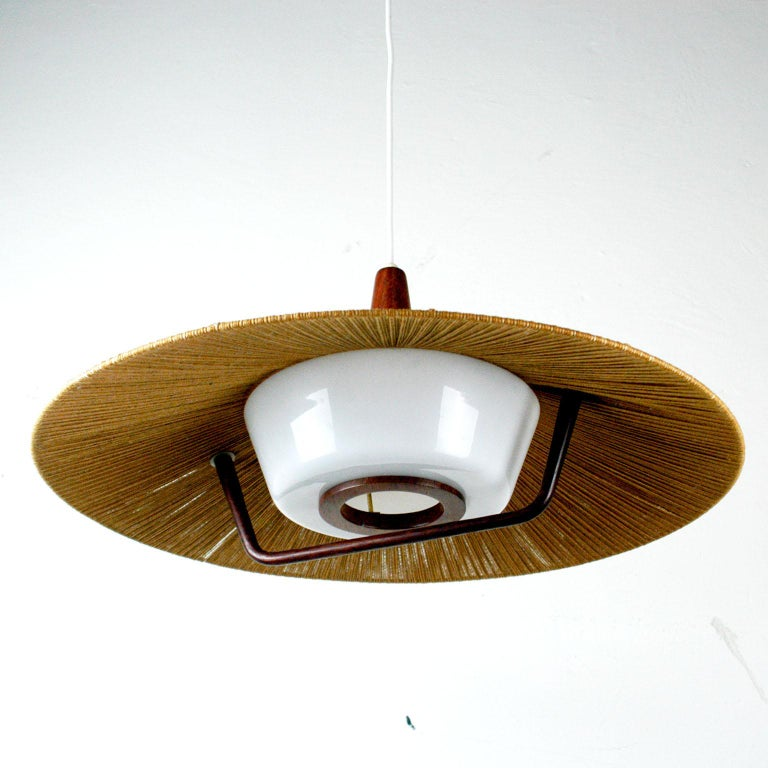 Very charming huge pendant lamp from the 1960s by the German manufacture Temde with cord shade and perspex diffuser in beautiful original condition. It has one E 27 light socket. Total height / length of the wire can be adjusted as customer likes.
