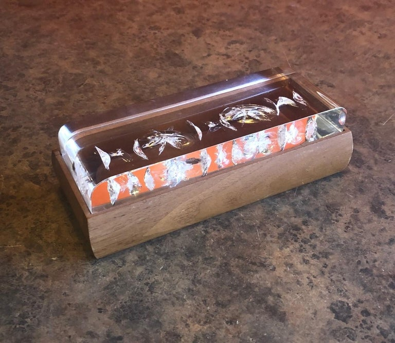 Mid-Century Modern walnut and Lucite trinket box, circa 1970s. The box measures 7.75