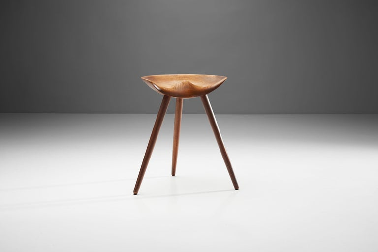 """This stool was designed in 1942, and at the time the design was simply called """"Taburet"""" (Stool in Danish), for as this model is well-known as """"the stool"""" of Mogens Lassen. The three-legged design was inspired by a traditional cobbler's stool, which"""