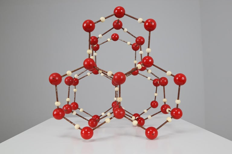 Molecular structure of water (H2O) for educational use, metal with wooden small spheres white painted, and with the larger spheres made of red painted bakelite. Czechoslovak manufacture of the 1950s.