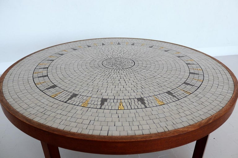 Gorgeous coffee table with big mosaic plate with white-off, grey and golden tiles on strong teak table base. The golden tiles are shining beautifully in the light! Made in Germany in the 1960s by Berthold Müller, Oerlighausen. The mosaic as well as