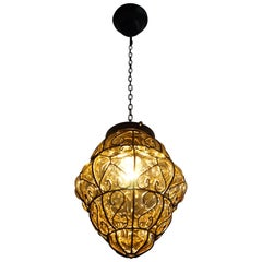 Midcentury Mouth Blown Amber Glass in Wrought Iron Frame Pendant Light Fixture
