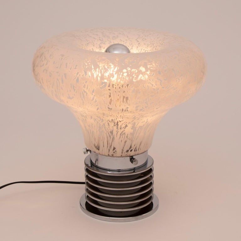 Midcentury Murano white and clear patterned glass light bulb lamp with heavy concentric chrome base in the manner of Carlo Nason