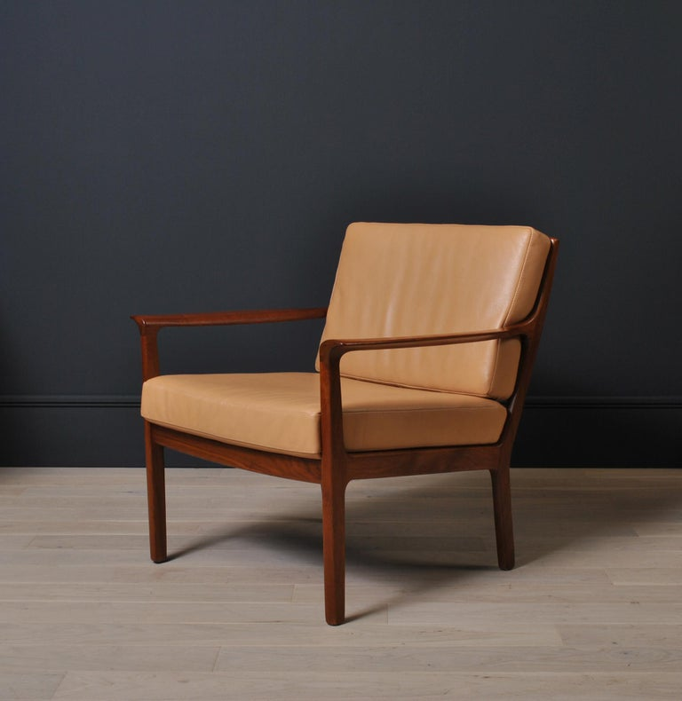 Elegant Nordic 1960's midcentury lounge chairs constructed from rich brown teak fully reupholstered in soft tan leather. Curved sweeping sculpted arms. More available with alternative upholstery options.