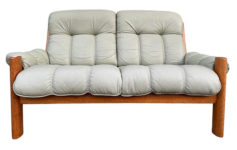 MidCentury Norwegian Modern Ekornesleather teak 2 seater sofa. Superb Light Sage green leather with solid teak wood frames. Beautiful condition and very comfortable. Great Norwegian design. Located in Brooklyn NYC