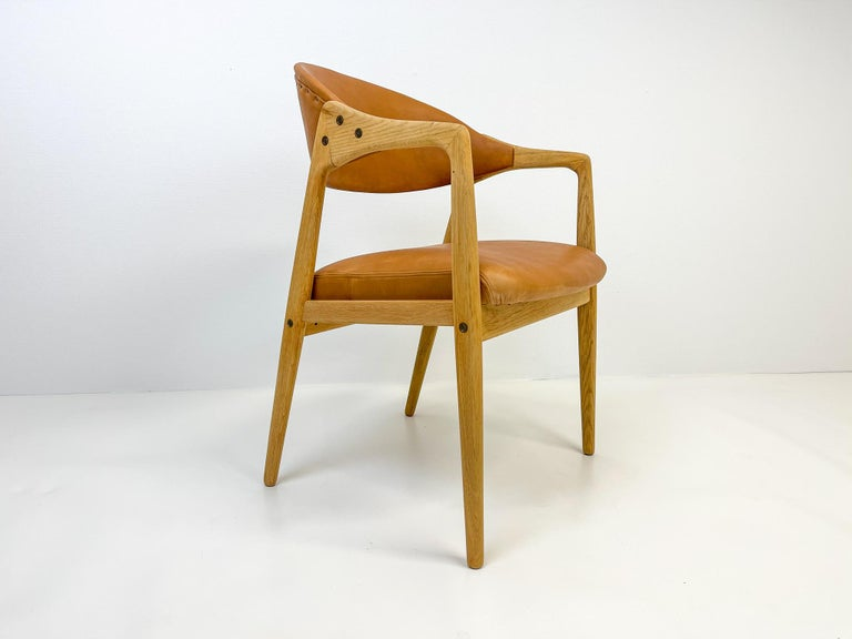 This wonderfully crafted desk chair named