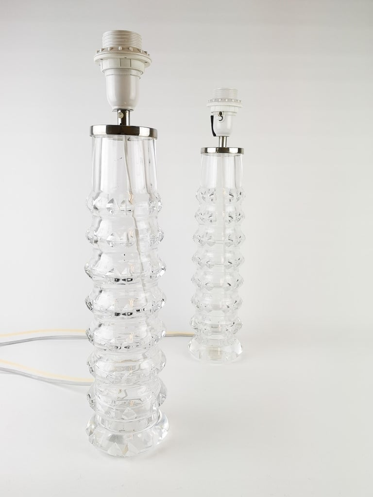 A pair of vintage table lamps designed by Carl Fagerlund for Orrefors, Sweden. Crystal glass. They are both signed in the bottom with Orrefors RD 207, circa 1970.  Nice condition, new wiring.