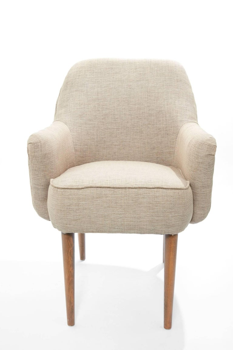 Mid-20th century pair of modern Danish petite upholstered armchairs    Dimensions: 34.5 in. H from top of chair to floor; 23 in. deep from front of chair to back of chair; 24 in. W from arm to arm.  Seat of chair is 17.5 in Wide x 17.5 in D and seat