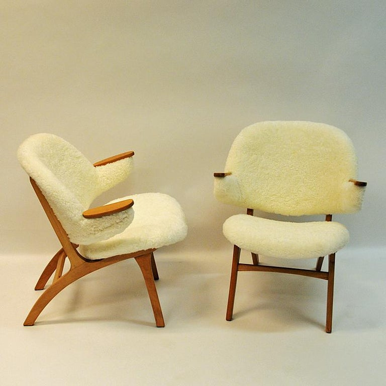 White, lovely and fluffy! These elegant easy chairs with new real white and soft sheepskin upholstery are designed by Solliden møbler in Norway 1950s. Birch legs and back. Very decorative in your home or holiday home and comfortable to sit in.