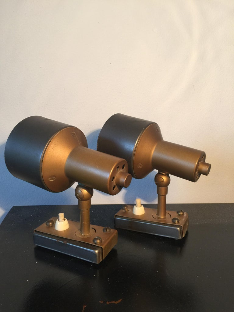 This pair of spotlights was produced in the 1950s in Italy by Stilnovo. They are made from aluminum and brass and are in original vintage condition with some visible scratches.