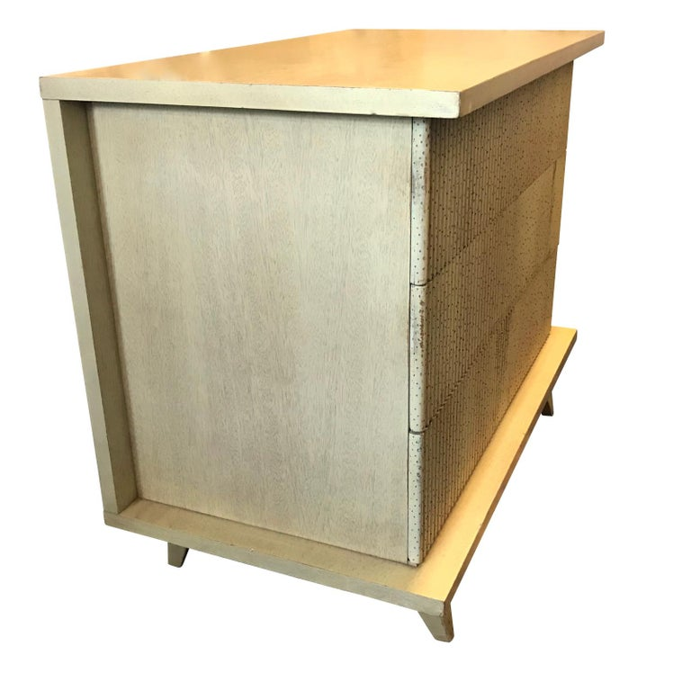 Pair midcentury textured rib front three-drawer commodes. Clean front, hardware free. Smooth recessed sides. Tapered legs. Sycamore.