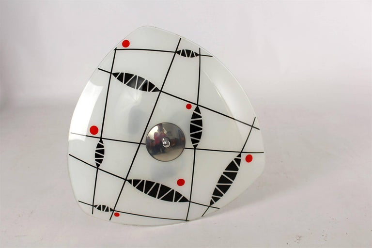Beautiful ceiling light dating from the 1950s or 1960s. Made in former Czechoslovakia by Napako. Features a patterned glass shade. The lamp is fully functional and requires three E27 bulbs.
