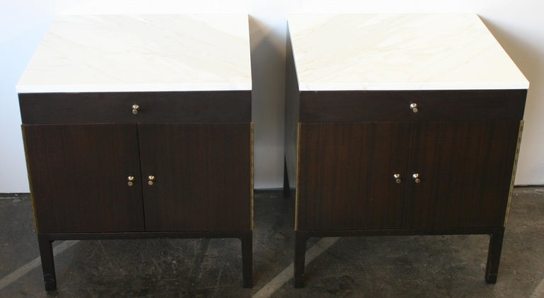 Beautiful pair of Paul McCobb early 1960s Production #7700 Walnut nightstands end tables with Calacatta gold Marble tops. Has single-drawer with lower cabinet that has 1 adjustable shelf. Original Vintage Condition. Very modern designed pair of