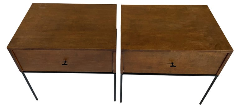 Beautiful pair of Paul McCobb Planner Group #1500 maple nightstands end tables single drawer. Black T pull knobs. Original vintage condition with walnut brown finish on maple. Very modern designed pair of nightstands with Iron Base with 4 legs. All