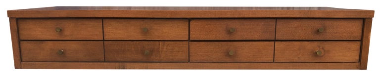 Nice Paul McCobb 3' small chest of drawers in solid maple construction with tobacco finish. Very high quality construction with original brass pulls. Made for top of dresser or bookcase. 8 brass knobs 4 drawers. Planner Group, Winchendon Mass. In