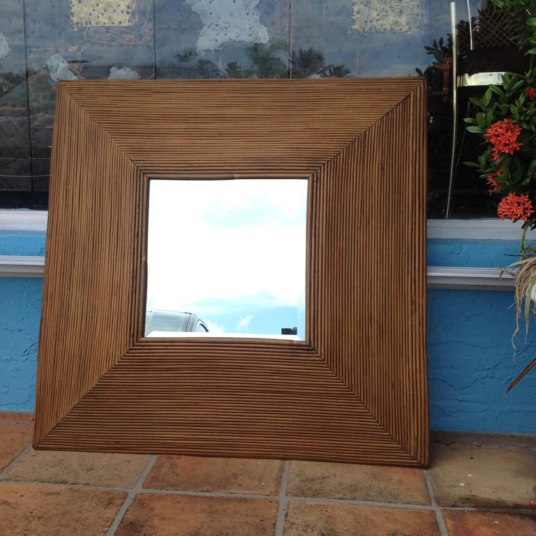 Dramatic design with flared out sides. The deep beveled mirror is original.