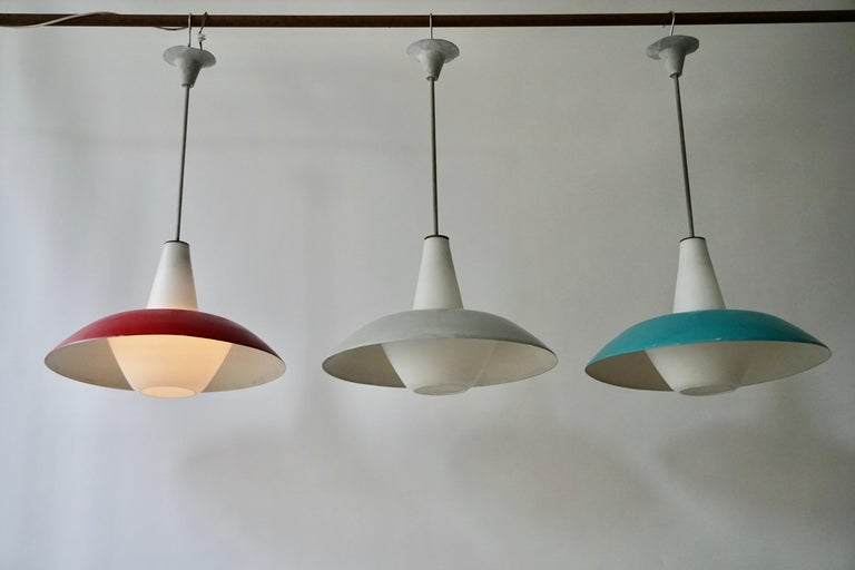 The lights consists of a large red, gray and blue metal shades with opaline glass fitted with one E27 socket.
