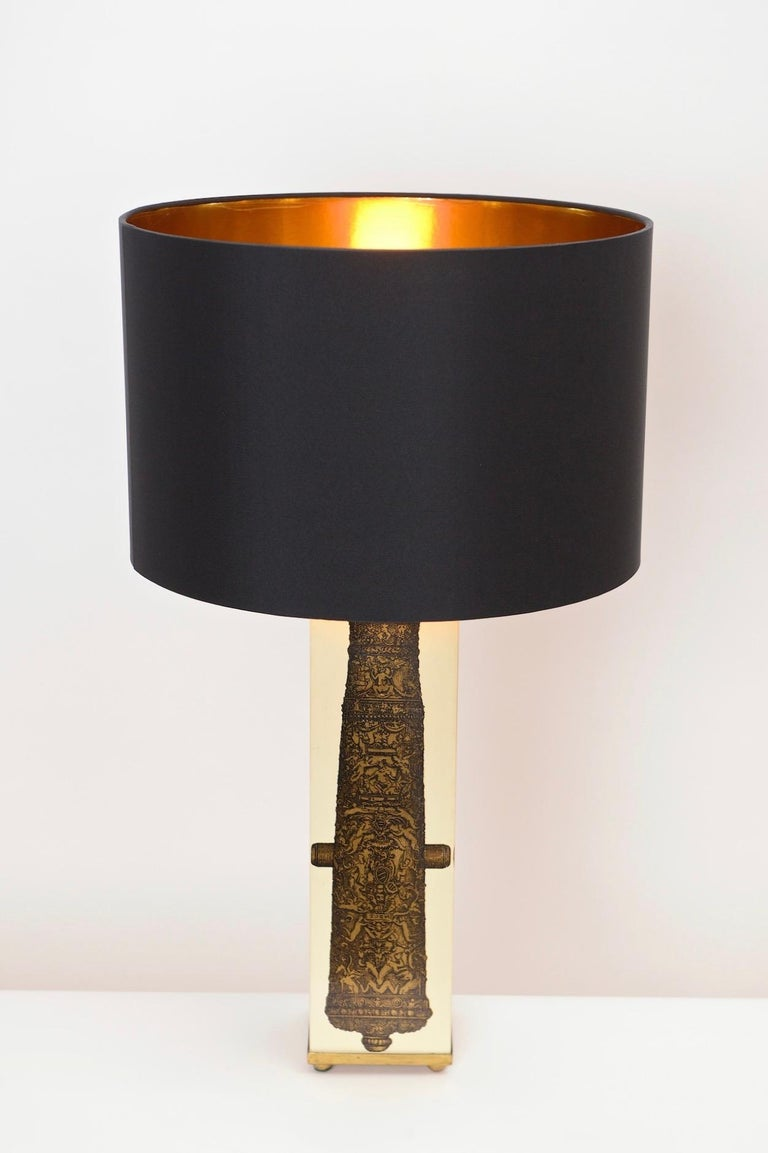A wonderful vintage table lamp by the great Italian designer and artist, Piero Fornasetti. Produced in the 1950s, this cuboid lamp features lacquered transfers of a decorative black and gold canon on each of its four sides. Signed on the underside