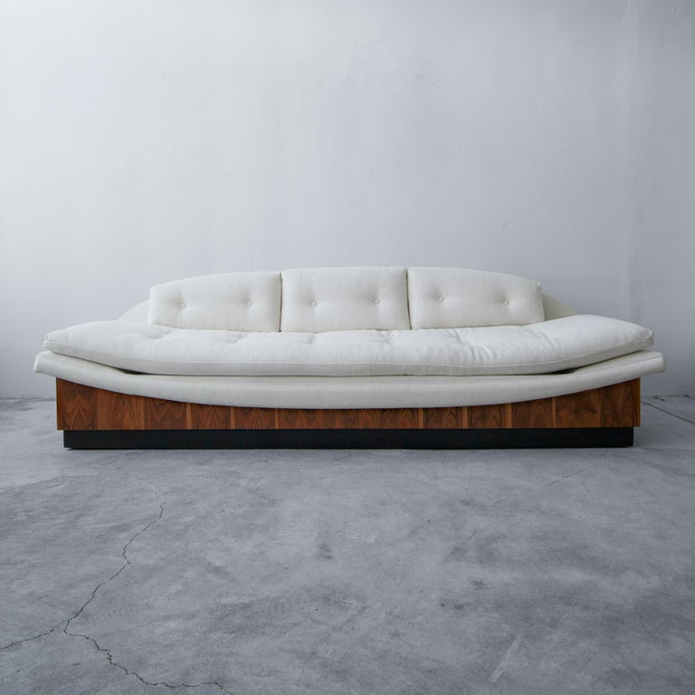 Absolutely stunning floating midcentury gondola sofa by Adrian Pearsall for Craft Associates. Amazing lines and details make it a real show stopper. It measures 9ft in length and is supported by a beautifully grained walnut platform that sits on a