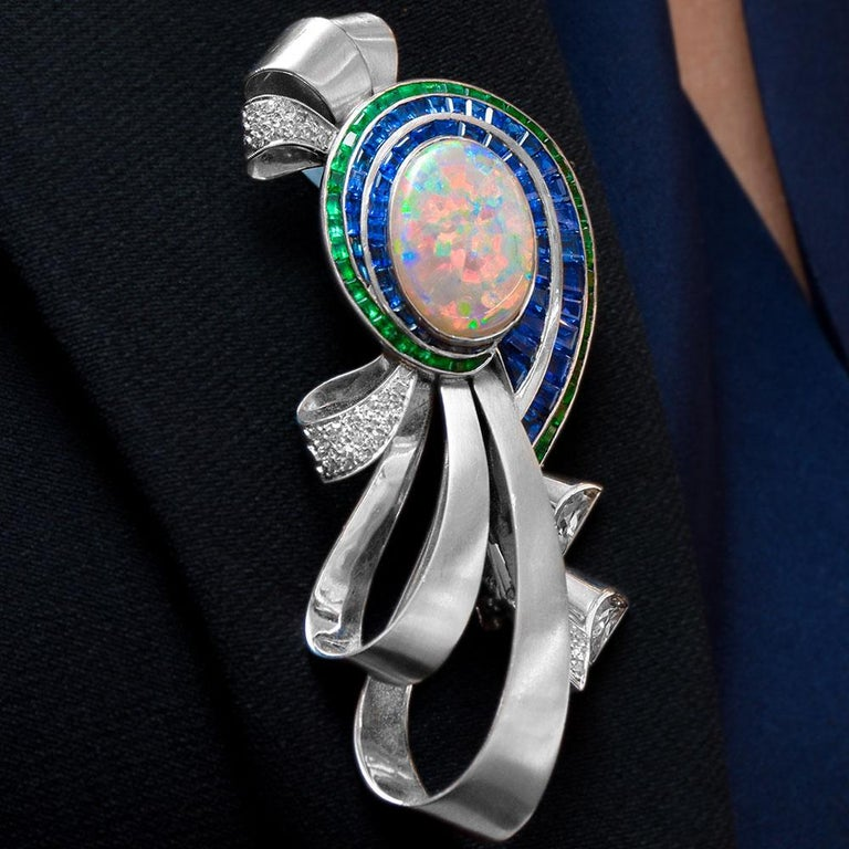 Retro Midcentury Platinum Brooch with Opal, Diamonds, Emeralds, and Blue Sapphires For Sale