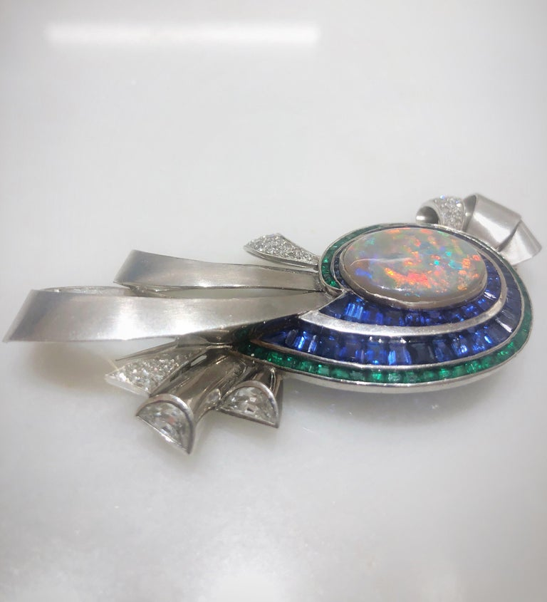 Midcentury Platinum Brooch with Opal, Diamonds, Emeralds, and Blue Sapphires In Excellent Condition For Sale In New York, NY