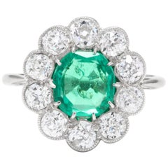 Midcentury Platinum, Emerald and Diamond Halo Ring