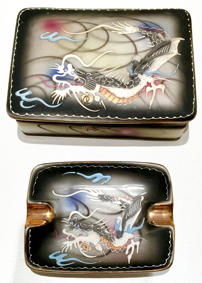 Japanese hand-painted moriage dragonware three-piece smoking set. Includes one footed box with lid and one ashtray with 22-karat gold detail.