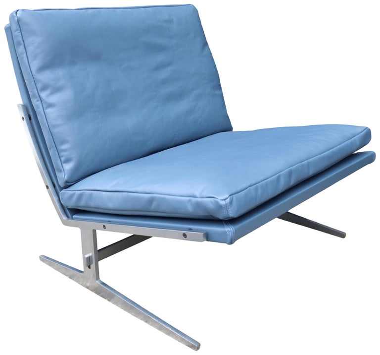For your consideration is this amazing Jørgen Kastholm & Preben Fabricius lounge chair in new leather upholstery matching the original blue color. Featuring a leather wrapped frame with down filled cushions on a stainless steel frame. A departure
