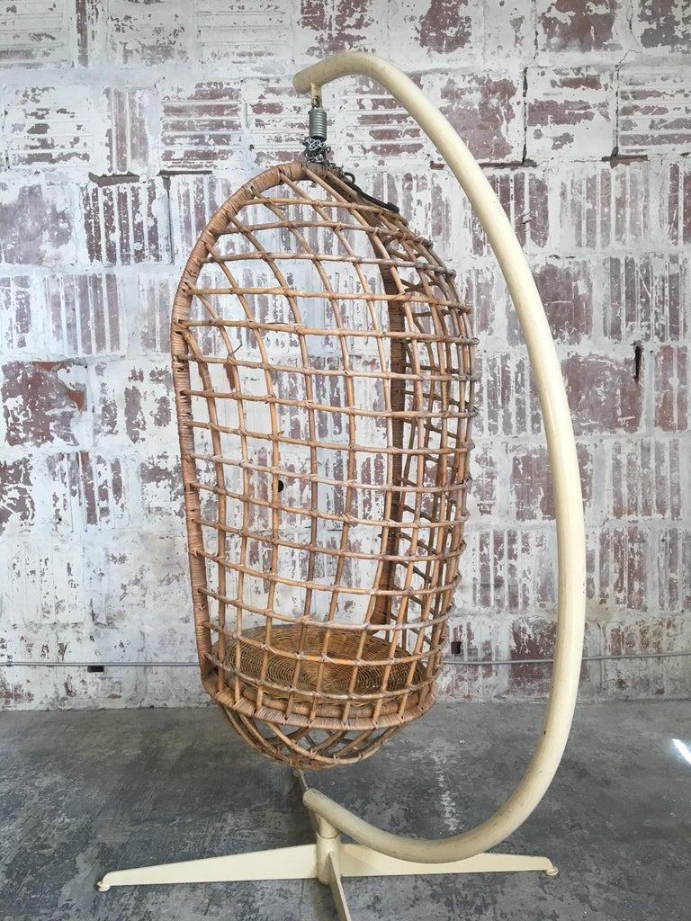 Vintage rattan hanging pod chair includes original steel stand. Also includes attached hook and chain for use without stand. Very good vintage condition with minor age-appropriate wear. Chair alone measures 17.5