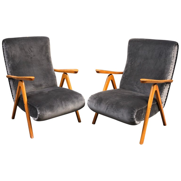 Midcentury reclining grey pearl velvet armchairs, set of two. They can be reclined in three positions. They conditions are very good. New upholstery and paddings, wooden parts restored in conservative way, they show some minor wears coherent with