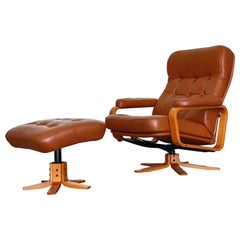 Midcentury Reclining Lounge Chair and Ottoman in Leather + Teak by Svend Skipper