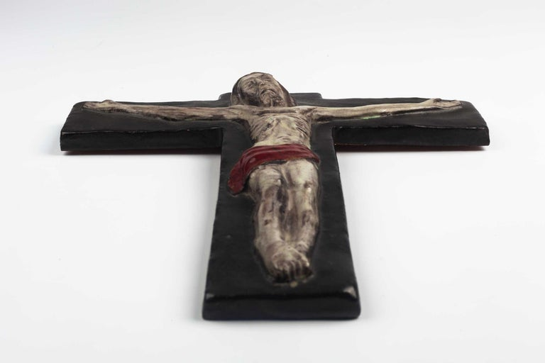 Midcentury European wall crucifix depicting Christ on the cross. From a large collection of vintage crosses handmade by Flemish artisans. 