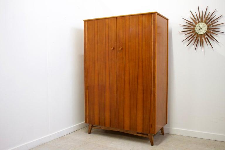 - Mid-Century Modern wardrobe. - Made from walnut and walnut veneer.