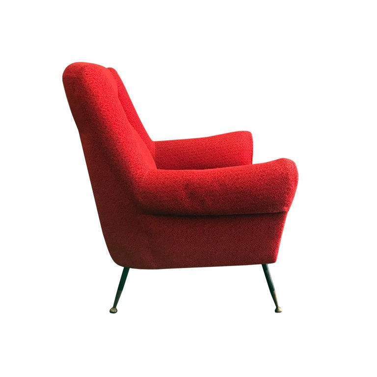 Midcentury rolled armchair in original red boucle with iron legs and brass sabots, Italy, 1950s.  Pair available, priced individually.