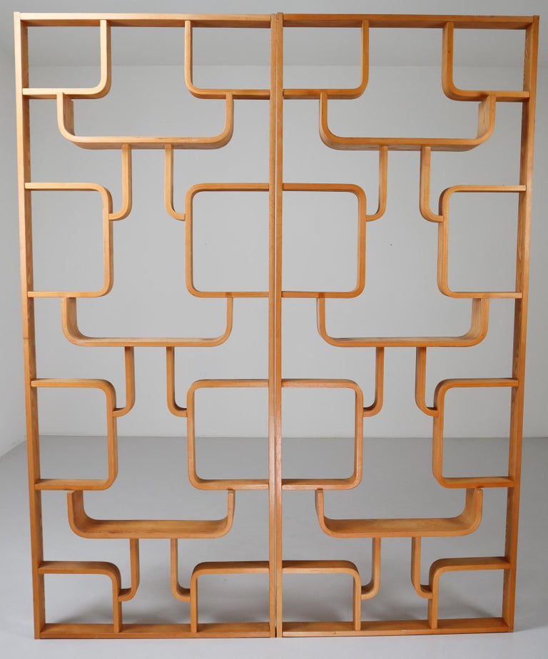 A unique set of two blond room dividers from a villa from Prague purchased from the original owner. These objects can be used as a wall-mounted shelving unit or room divider. Square edges in blond color plywood and features geometric patterns.