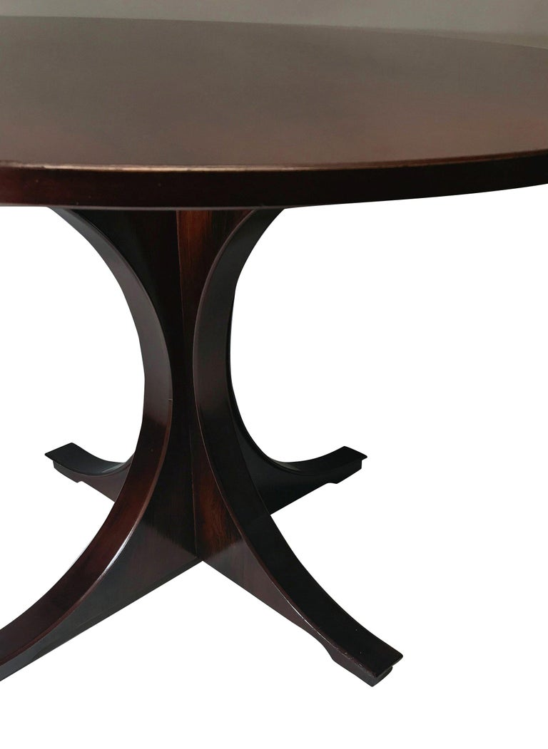 An Italian sculptural centre table in rosewood. On an attractive splayed base and good figuring to the top.