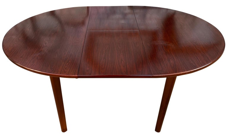 Danish Midcentury Rosewood Expandable Round Dining Table with 1 Nesting Leaf For Sale