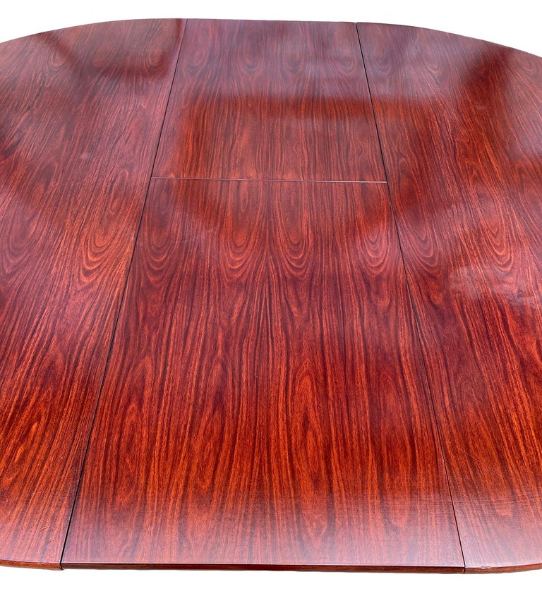 Mid-20th Century Midcentury Rosewood Expandable Round Dining Table with 1 Nesting Leaf For Sale