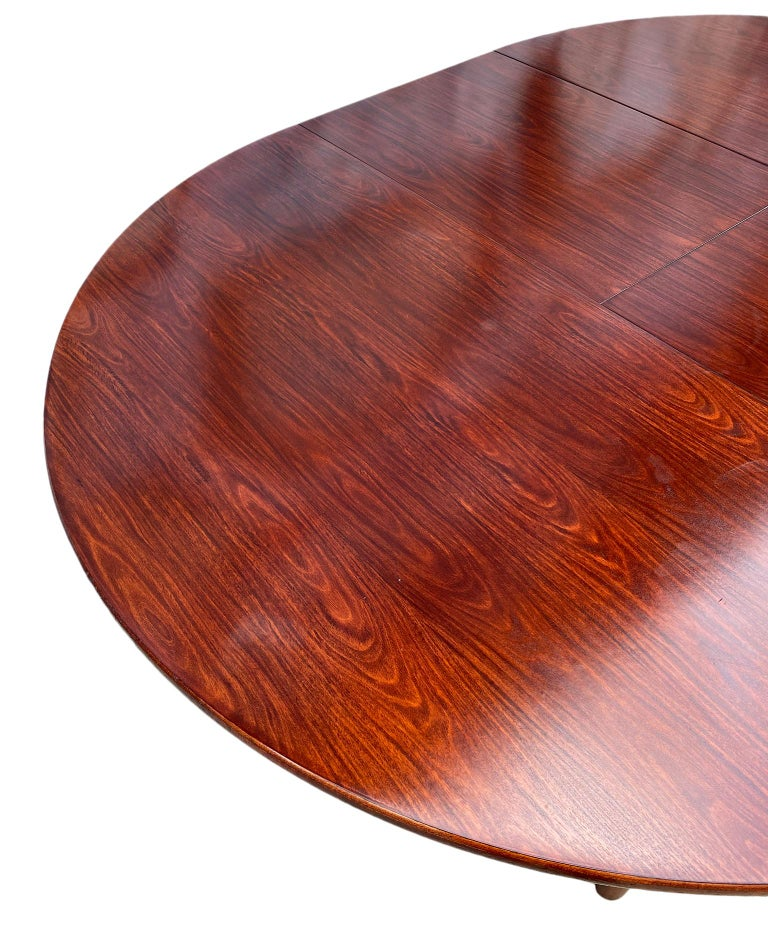 Midcentury Rosewood Expandable Round Dining Table with 1 Nesting Leaf For Sale 1