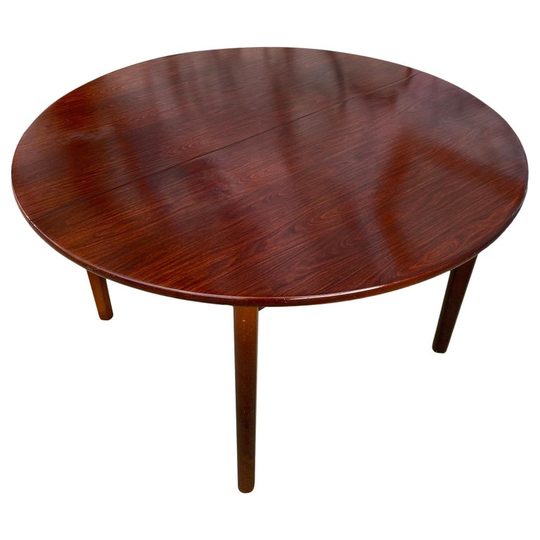 Midcentury Rosewood Expandable Round Dining Table with 1 Nesting Leaf For Sale