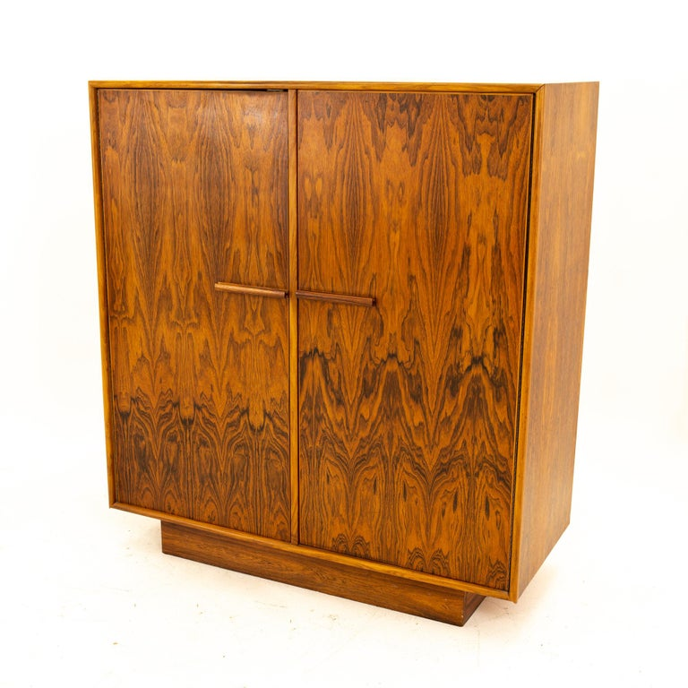Mid Century rosewood highboy armoire dresser Dresser measures: 42 wide x 18.5 deep x 47 high  All pieces of furniture can be had in what we call restored vintage condition. That means the piece is restored upon purchase so it's free of watermarks,