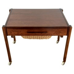 Midcentury Rosewood Table with Sectioned Drawer and Storage Basket