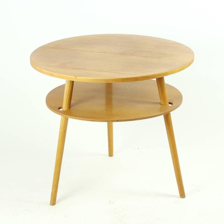 Simple Yet Elegant Round Wooden Coffee Table Sanding On Three Legs Completely Red And
