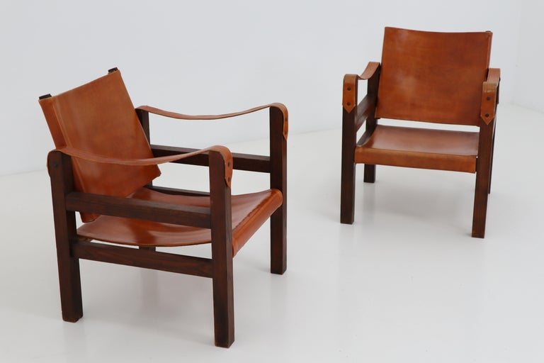 A pair of 1960s Safari chairs in oak and cognac patinated leather. In very good vintage condition, with a lovely patina.