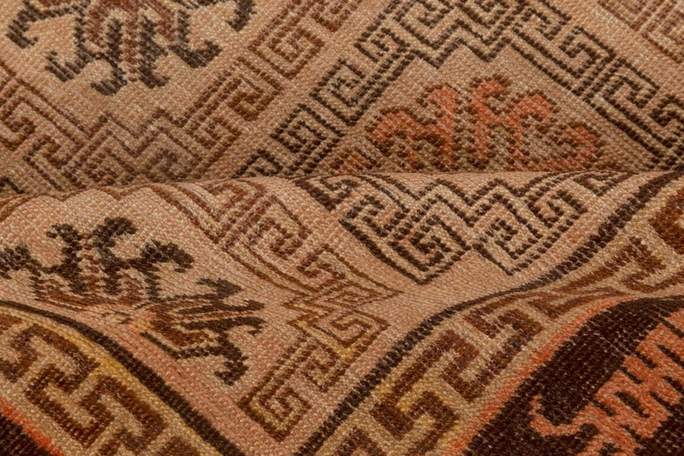 Midcentury Samarkand handmade wool rug in beige, brown and orange Size: 4'6