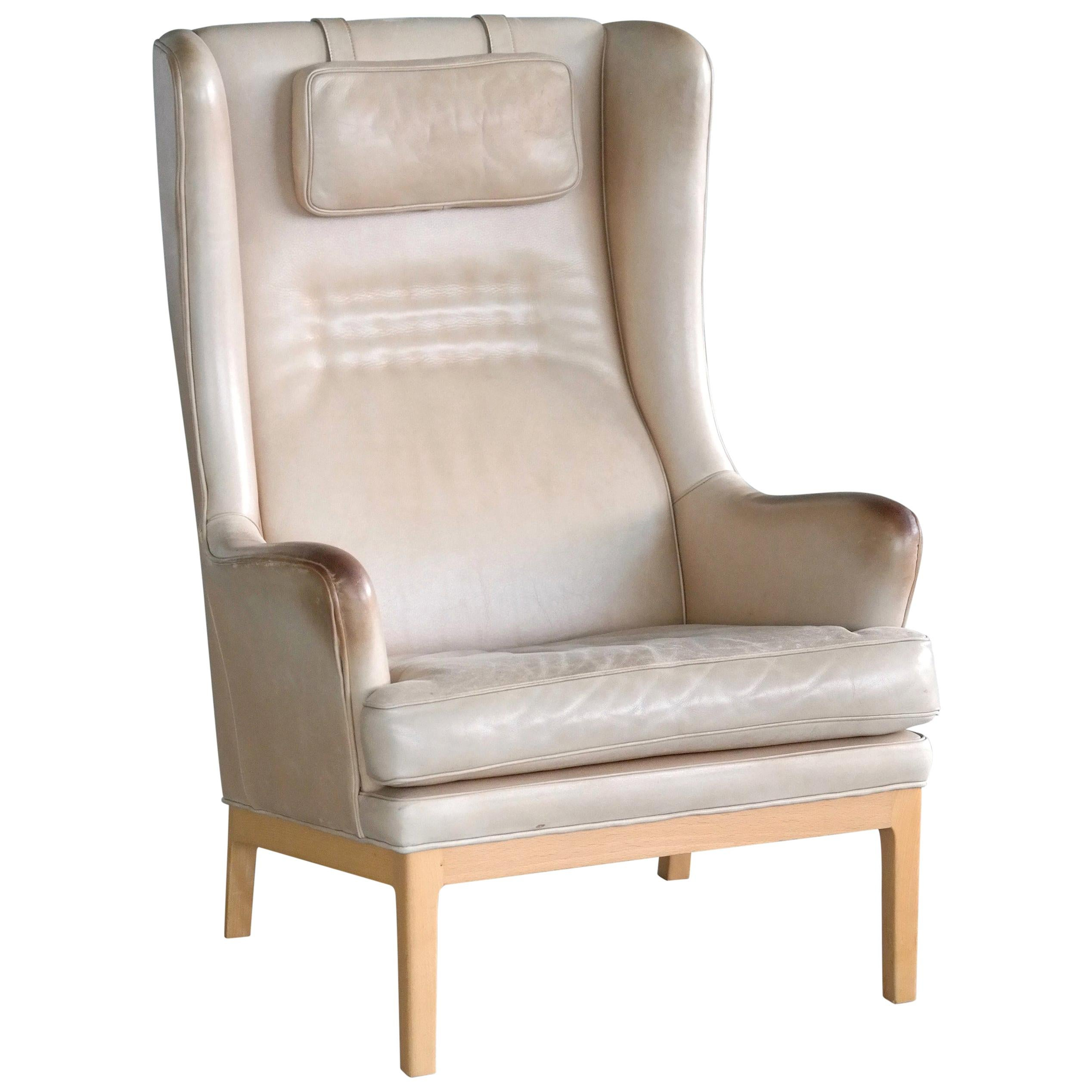 Midcentury Scandinavian Arne Norell High Back Lounge Chair in Worn Tan Leather